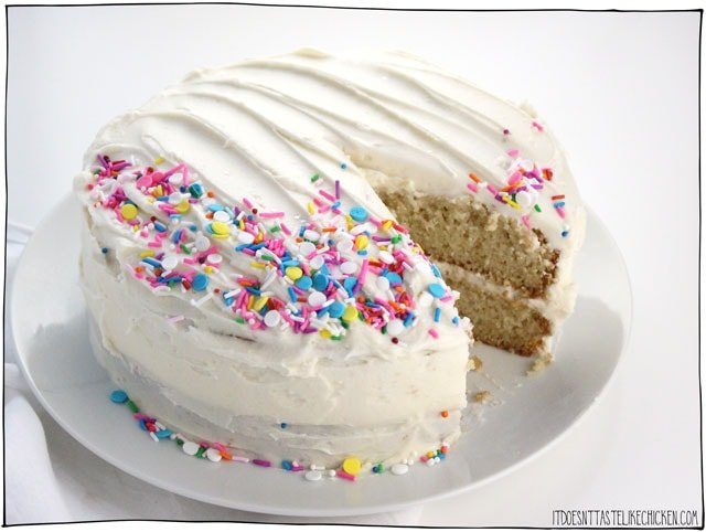 The Best Vegan Vanilla Cake (or Cupcakes) recipe!! Sweet, buttery, vanilla-infused, fluffy and moist all at the same time. Easy to make and even easier to eat. No one will even notice it's vegan! Perfect for birthday parties, celebrations, or holidays. #itdoesnttastelikechicken #veganrecipes #vegandesserts #vegancake