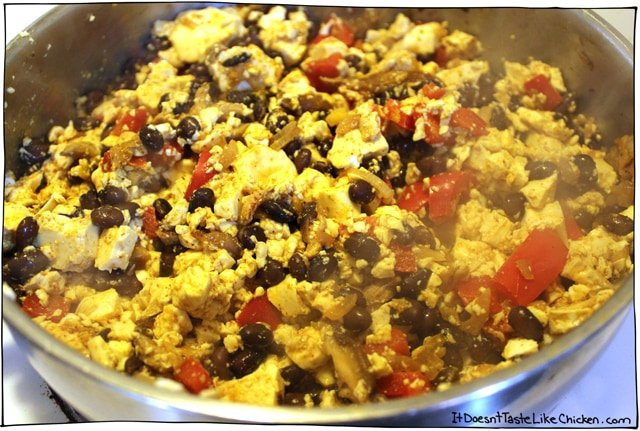 Tofu Scramble: Breakfast of (vegan) champions! This is my favourite hearty classic vegan breakfast recipe. Spiced to perfection with peppers, beans, onions, and mushrooms for a perfect savoury brunch. #itdoesnttastelikechicken #veganrecipes #veganbreakfast #tofu