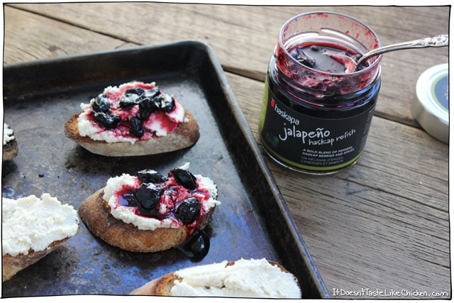 Macadamia Ricotta and Haskap Crostini! This makes such a cute and easy vegan appetizer. Recipe for vegan macadamia ricotta, toast baguette slices, then top with a haskap berry relish! #itdoesnttastelikechicken