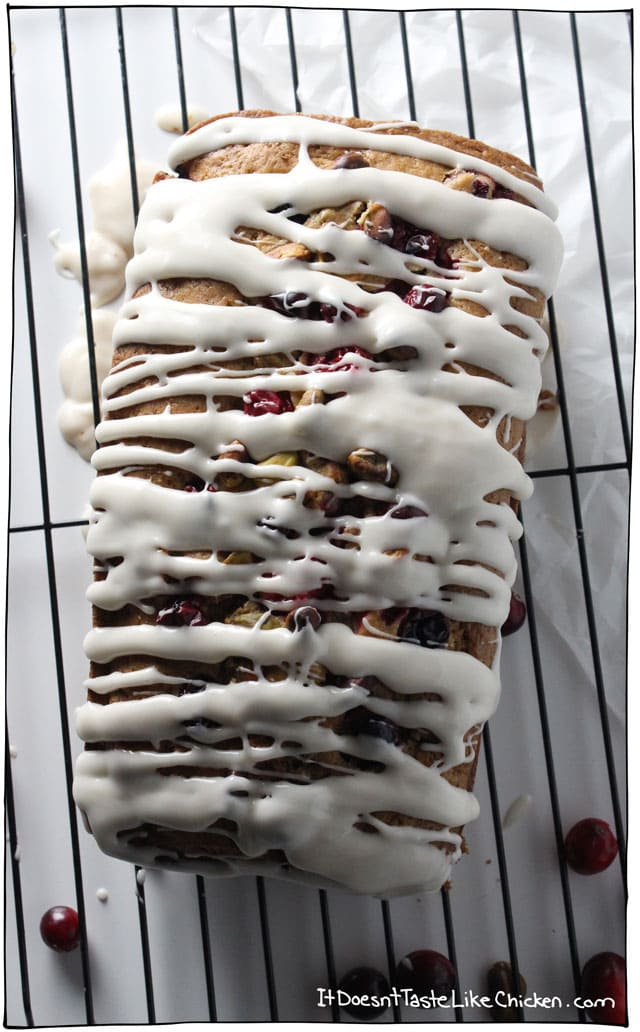 Vegan Cranberry Pistachio Loaf with icing. Easy to make and a perfect morning treat with coffee or tea. Looks very festive for the holiday season and Christmas, but delicious anytime of year. #itdoesnttastelikechicken #VMBC