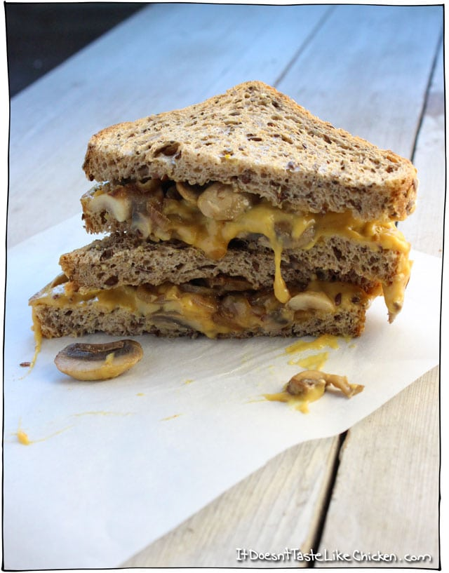 Vegan Caramelized Onion & Mushroom Grilled Cheese! Yes this is vegan, and yes this is insanely delicious! Comfort food that's healthy! Yes please. Make this dairy free nacho cheese in just 15 minutes, sauté up some onions and mushrooms, layer them on the bread, and grill to perfect. So easy and so unbelievably good. #itdoesnttastelikechicken