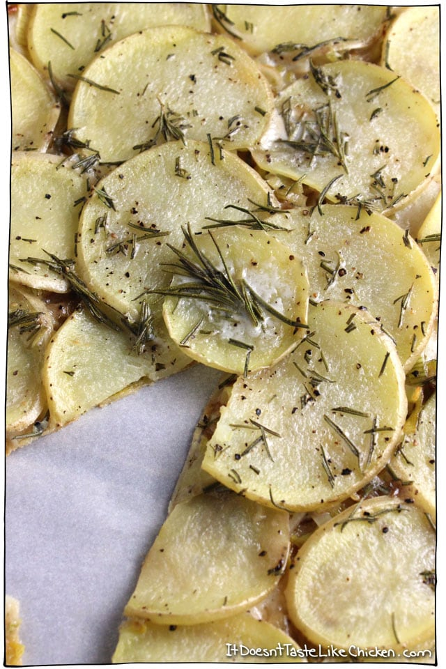 Vegan Leek & Potato Pizza! This pizza looks fancy but it is actually so easy to make. The layers of leek, potato, rosemary, and coconut milk make this pizza so flavourful and delicious. Perfect for an appetizer or the main dish. #itdoesnttastelikechicken