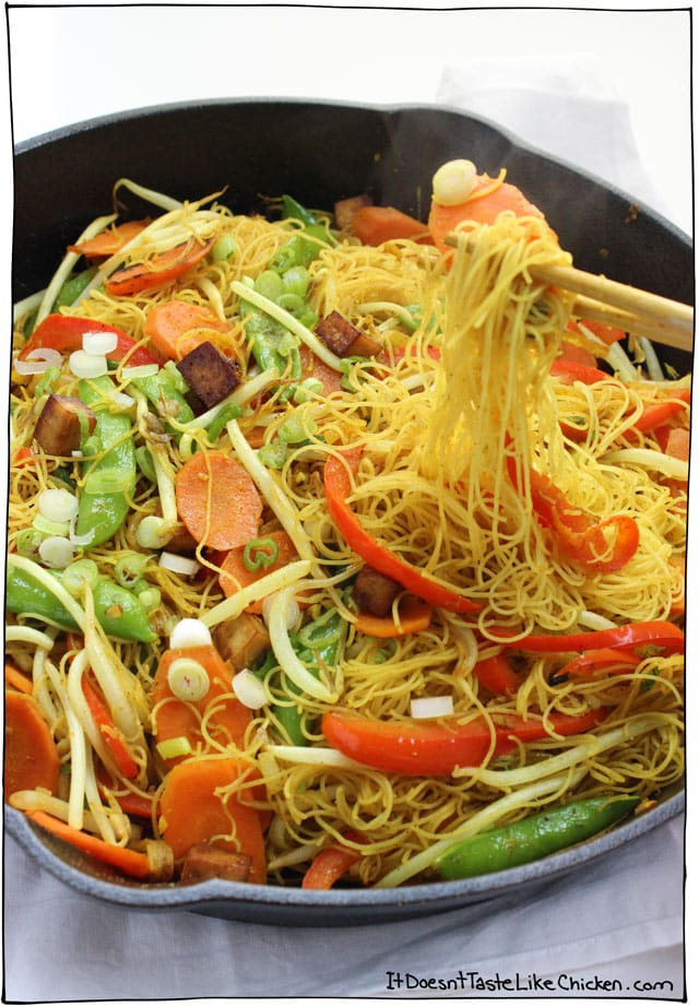 Vegan Singapore Noodles! Slightly spicy, jam-packed full of curry deliciousness, tossed with medley of veggies, and chewy tofu bites. This is a great recipe for cleaning out the fridge. So quick and easy!