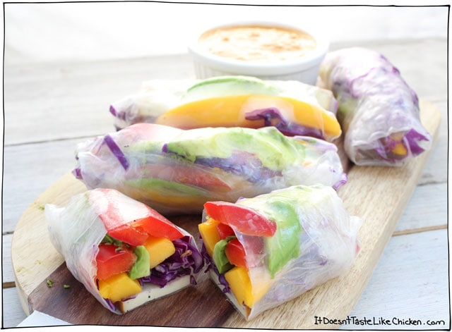 Smoked Tofu & Mango Spring Rolls are the perfect combo of smoky tofu, sweet mango, creamy avocado and crisp veggies, all topped with a peanut dipping sauce. Perfect vegan, vegetarian, gluten free appetizer. #itdoesnttastelikechicken