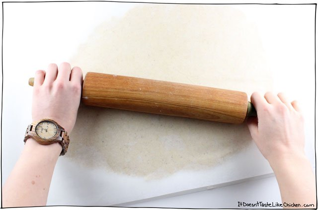 Roll the sugar cookie dough between two sheets of parchment paper.