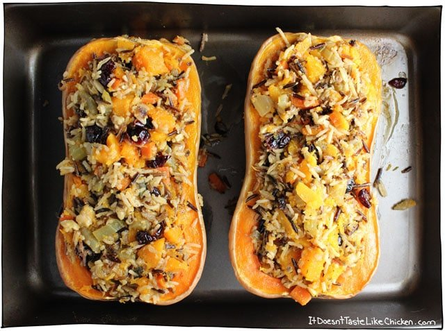 Stuffed Roasted Butternut Squash! The perfect vegan centrepiece main dish for Thanksgiving, Christmas, or any holiday. Stuffed with super flavourful wild rice, cranberries, walnuts, and sage filling. Can be made up to 3 days ahead of time and warmed up before serving. Gluten free, vegan, vegetarian, dairy free. #itdoesnttastelikechicken