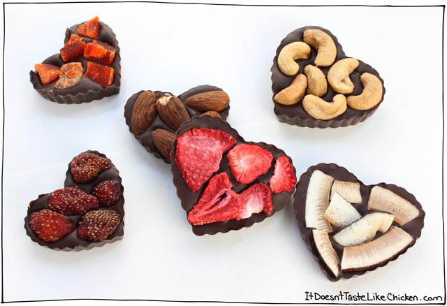 Easy Fruit & Nut Vegan Chocolates! This Valentine's Day gift recipe is so incredibly easy, just melt dairy-free chocolate chips, pour into a mold or onto parchment paper, then top with your favourite dried fruit and nuts. #itdoesnttastelikechicken