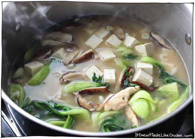 Miso Udon Noodle Soup- I could eat this soup every day! A simple miso broth with bok choy, shiitake mushrooms, soft tofu, and udon noodles. Vegan and vegetarian friendly #itdoesnttastelikechicken
