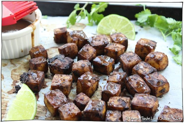 4 Ingredient Jerk Tofu! It's mouth-explodingly flavourful, perfectly spiced, with a fresh squeeze of lime. Slowly baking the tofu gives it this amazing sink your teeth into chewy texture. Vegan, vegetarian, Jamaican inspired. #itdoesnttastelikechicken