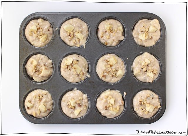 Vegan Banana Nut Muffins! Bursting with banana flavour, little pops of nut crunch, tender, lightly sweet, and gorgeously moist. Dairy-free, egg-free. #itdoesnttastelikechicken