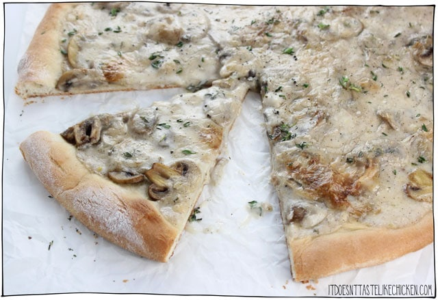 Creamy Vegan Coconut Mushroom Pizza! This decadent mushroom lovers pizza is covered in a rich dairy-free coconut sauce that bubbles and browns to perfection in the oven. #itdoesnttastelikechicken