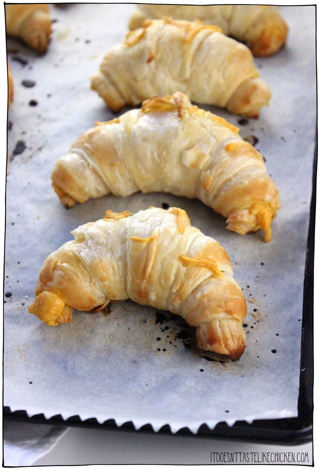 Super Easy Vegan Croissants! This recipe hack uses store-bought puff pastry to make the worlds easiest croissants. You can enjoy them plain, stuffed with chocolate, or dairy-free cheese. Serve them warm out of the oven for brunch or breakfast. #itdoesnttastelikechicken #veganrecipes #croissants #veganbaking