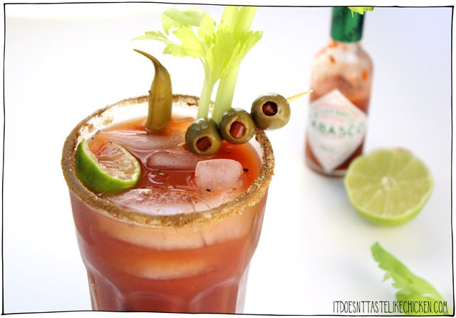 Vegan Caesar Cocktail! The Canadian classic drink veganized. The secret ingredient is olive brine (the liquid in a jar of olives) which adds a brininess to the cocktail which is irresistibly delicious. So quick and easy to whip up, it's the ultimate hangover cure. Perfect for Canada day! #itdoesnttastelikechicken #veganrecipes #caesar