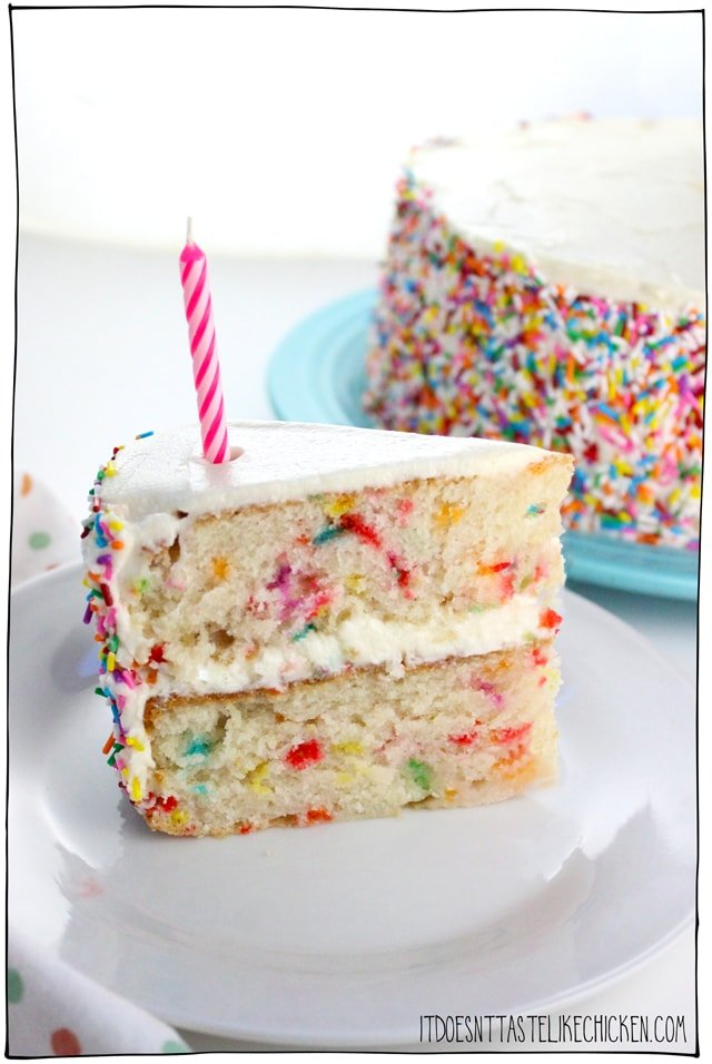 Vegan Confetti Cake! A delicious vanilla cake with sprinkles stirred into the batter to make spots of bright color throughout. Perfect for a vegan birthday cake! Deliciously moist and sweet, this rainbow cake is perfect for a birthday party. #itdoesnttastelikechicken #veganrecipes #vegandesserts #vegancake