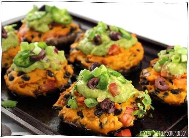 Vegan Nacho Stuffed Portobellos! Portobello mushrooms are stuffed with a homemade vegan nacho cheese filled with black beans and tomato. Bake or grill the mushrooms then top with guacamole for a fiesta in your mouth! Makes a great main when paired with Mexican rice and corn on the cob. #itdoesnttastelikechicken #veganrecipes #veganmains