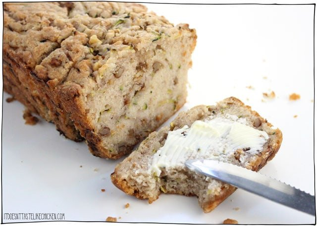 Easy Vegan Zucchini Bread! Tastes just like banana bread except without the bananas. It's lightly sweet, with a hint of cinnamon, a walnut crunch, and the best part (and the magic zucchini provides), it's extra-extra-moist. The best vegan zucchini bread recipe and a great way to use up extra zucchini! #itdoesnttastelikechicken #veganrecipes #zucchini