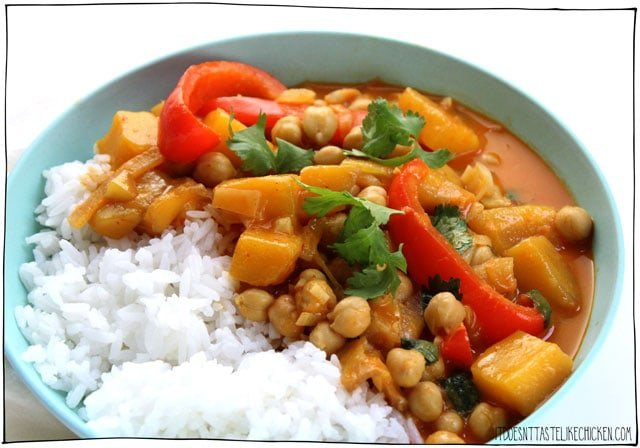Thai Mango Chickpea Curry! An easy weeknight meal- just 25 minutes to make! Sweet juicy mango, hearty chickpeas, in a coconut milk sauce infused with aromatic Thai yellow curry on a bed of steamy, fluffy rice. This sweet curry is kid-friendly but can be made spicy if desired. #itdoesnttastelikechicken #veganrecipes #curry