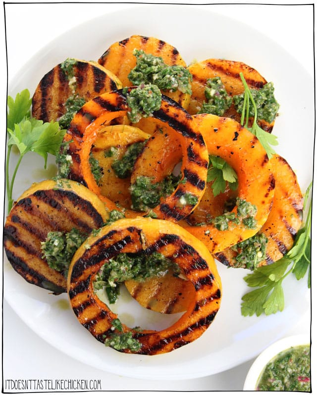 Grilled Butternut Squash with Chimichurri! Grilling squash brings out the flavours in a whole new way. A recipe that's quick and easy enough to make on a weeknight, but that happens to be gorgeous enough to look like the centerpiece for a holiday feast! #itdoesnttastelikechicken #veganrecipes #squash