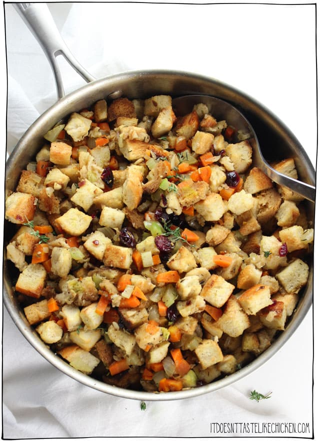 Easy Vegan Stove Top Stuffing!! The perfect traditional stuffing for Thanksgiving or Christmas. Just 30 minutes and can be made ahead of time. Perfectly seasoned, fluffy, with sage, thyme, rosemary and dried cranberries. #itdoesnttastelikechicken #veganrecipes #veganthanksgiving #thanksgiving