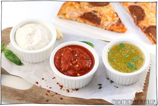 3 Vegan Pizza Dips! Creamy garlic, spicy marinara, and garlic butter. Quick and easy to make with just a few ingredients each, you can make all three in the time it takes to order a pizza or cook your own! #itdoesnttastelikechicken #veganrecipes #veganpizza