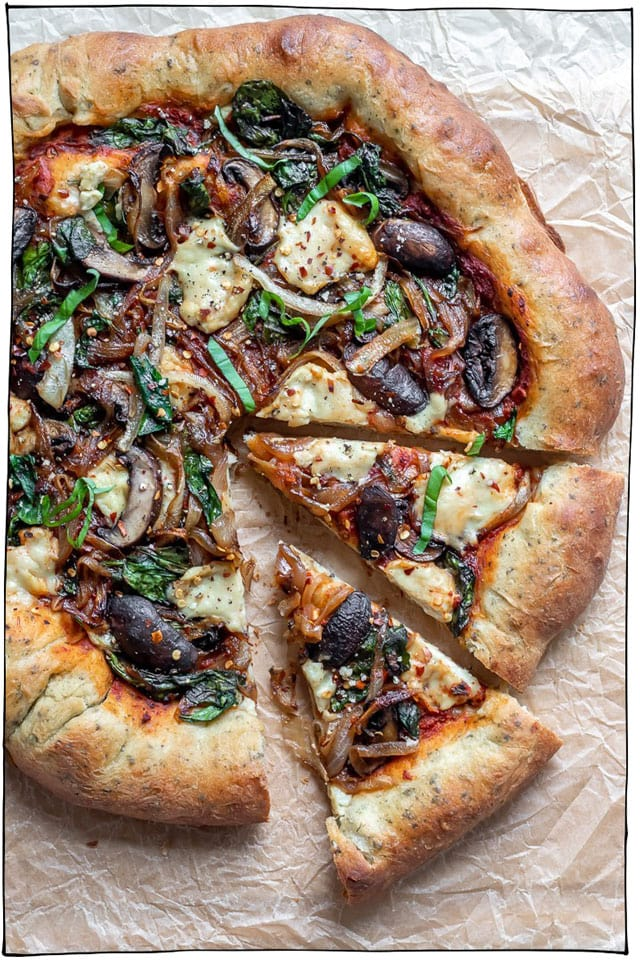 The Best Vegan Pizza Recipes! Whether you prefer classic toppings such as melty vegan cheeses, tomato sauces, basil, and pepperoni or you're into more adventurous pizza toppings like nacho pizza, coconut pizza, jalapeno popper pizza, and breakfast pizza, I've got the best vegan pizza recipes on the net for you right here. #itdoesnttastelikechicken #veganrecipes #veganpizza