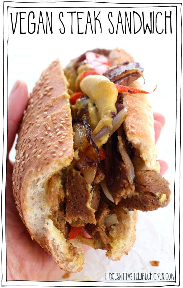 Vegan Steak Sandwich! This sandwich is packed with steak slices, sauté with onions, red bell pepper, and garlic, all topped with melty nacho cheese, and did I mention it's vegan!? #itdoesnttastelikechicken #veganrecipes #vegansandwich