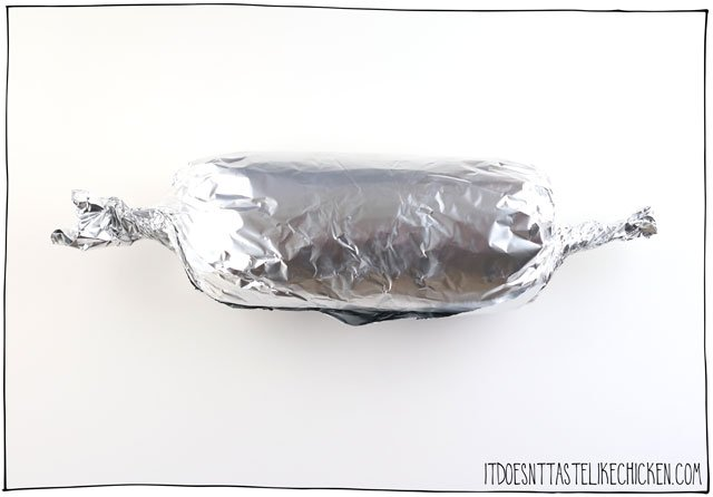 Roll up the vegan bologna in foil like a large candy, or you can alternatively wrap the baloney in parchment paper and then cheesecloth tying the ends closed.