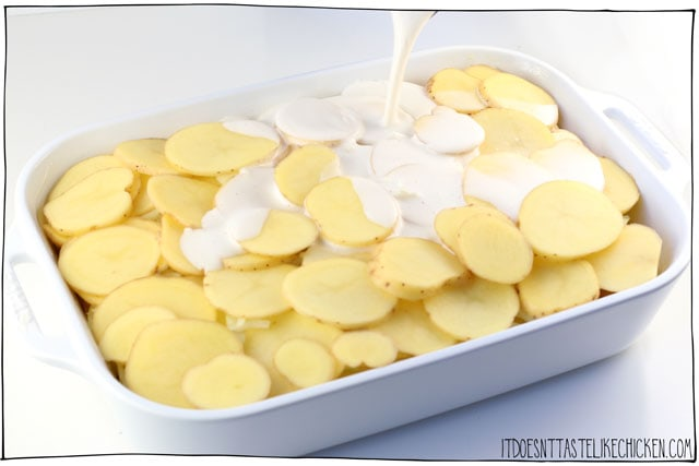 Pour the creamy sauce over the potatoes before baking.