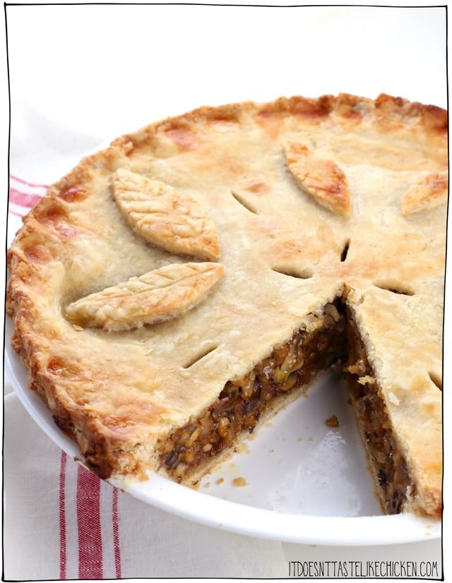 Vegan Tourtiere (vegan meat pie). This savoury pie is made with tofu and mushrooms for the best chewy, juicy, meaty texture. A fantastic centrepiece for Thanksgiving or Christmas. Make ahead. Gluten-free and oil-free options. #itdoesnttastelikechicken #veganrecipes