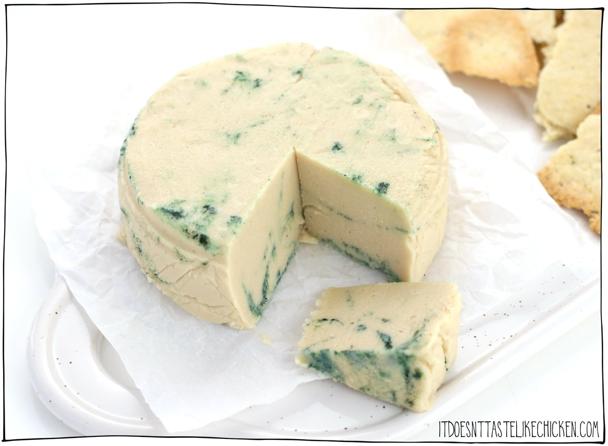 Easy Vegan Blue Cheese Recipe! Just 8 ingredients, 20 minutes to make (plus chilling time), and you can make your own homemade vegan blue cheese! This dairy-free cheese is creamy, tangy, got that funky kick to it, and even has the pretty green and blue veins throughout. #itdoesnttastelikechicken #veganrecipes #vegancheese