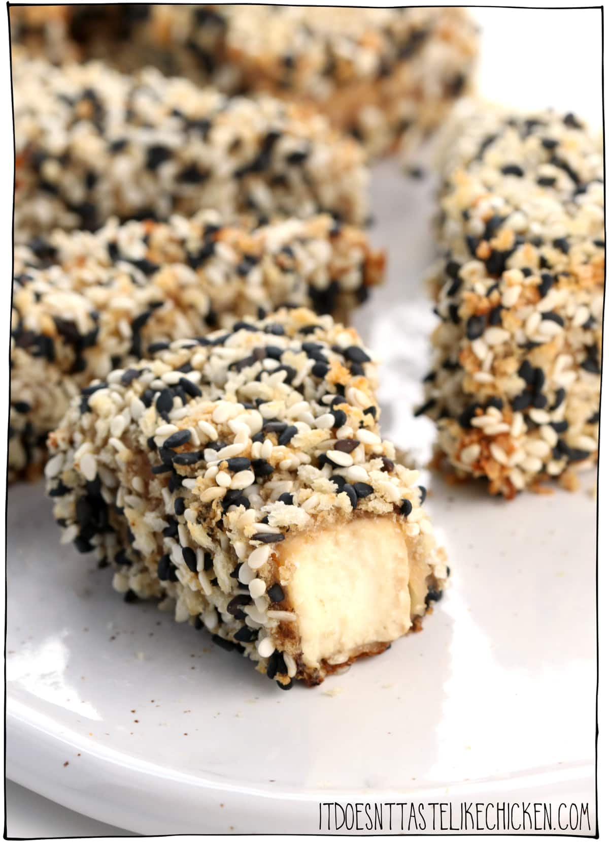 Crispy Sesame Crusted Tofu! Marinated tofu in a crispy crunch sesame crust. Great for a vegan appetizer or as a main dish served with your favourite sides. Gluten-free and oil-free options. #itdoesnttastelikechicken #veganrecipe #tofu