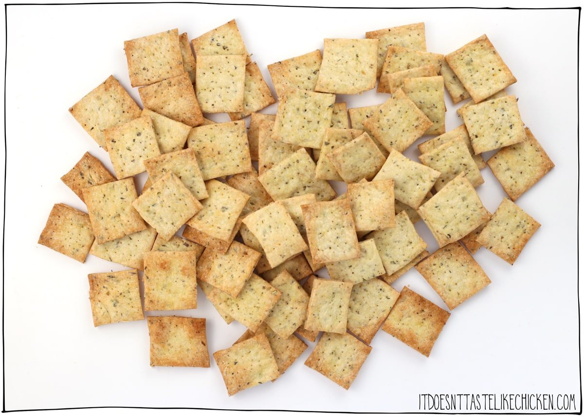 Easy Crispy Vegan Crackers! Just 9 ingredients to make these super crunchy crackers. Perfect for serving with your favourite vegan cheese, hummus, or any dip, or enjoy as a snack all on their own. #itdoesnttastelikechicken #veganrecipes #vegansnack
