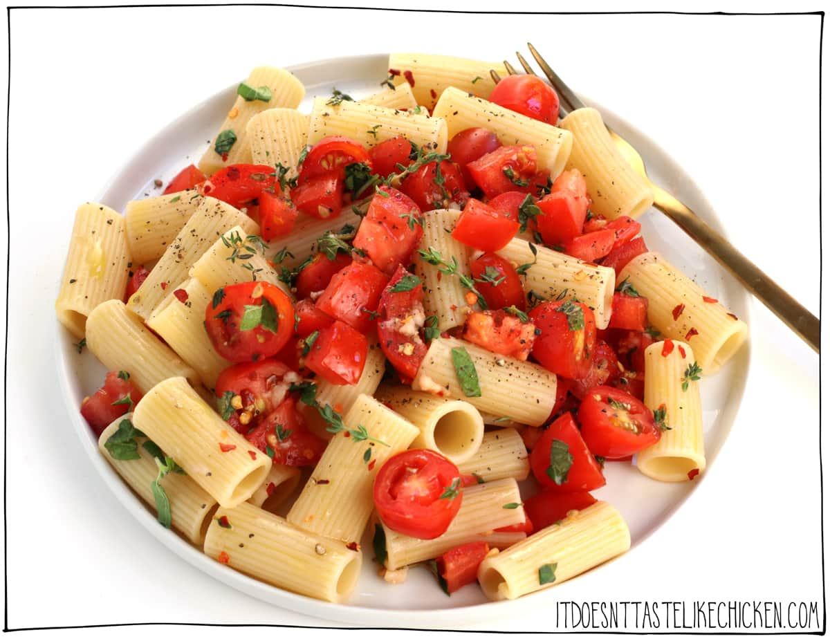Fresh Tomato Pasta- my favourite summer pasta recipe. Super easy and quick pasta to make. Endless variations, use any kind of pasta, any kind of tomatoes, and any kind of herbs! No matter the combo, it always turns out so delicious. The no-cook sauce couldn't be simpler to make. Just chop, mix, and toss with hot pasta. That's it! #itdoesnttastelikechicken #veganrecipes #pasta