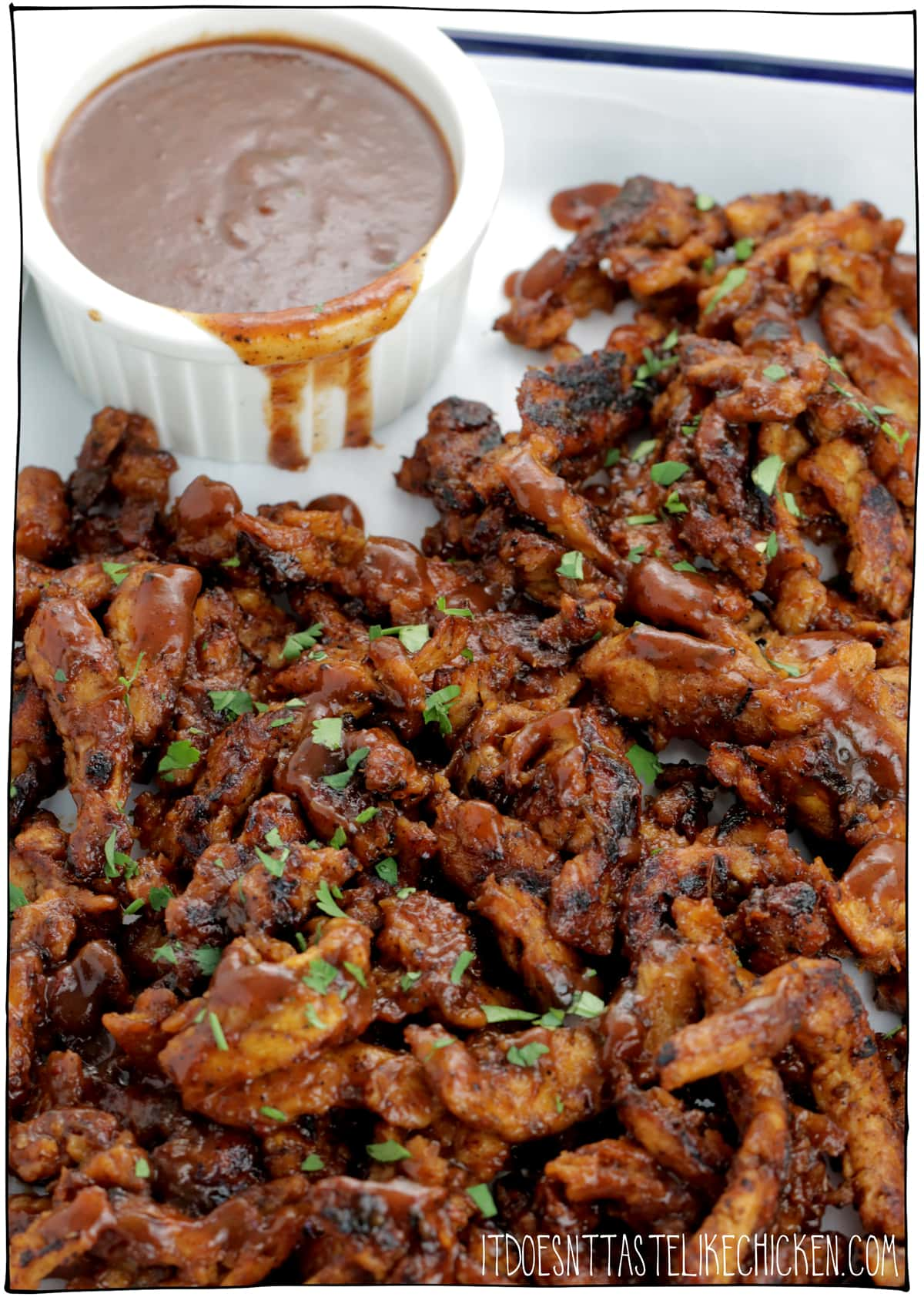 Vegan Jerk BBQ Soy Curls! 20 minutes and just 4 ingredients to make! Spicy, saucy, tender, to die for delicious. Serve them along with some rice and coleslaw, pile them high on a bun, roll them into a wrap, or top a grain bowl. #itdoesnttastelikechicken #veganrecipe #soycurls