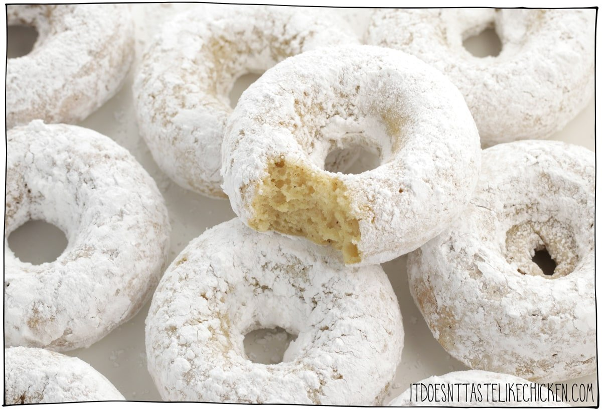 Vegan Powdered Donuts! Homemade donuts are easy to make and taste just like old fashioned white sugar powdered donuts. These baked donuts are the perfect dessert or snack! #itdoesnttastelikechicken #veganrecipes #donuts #veganbaking