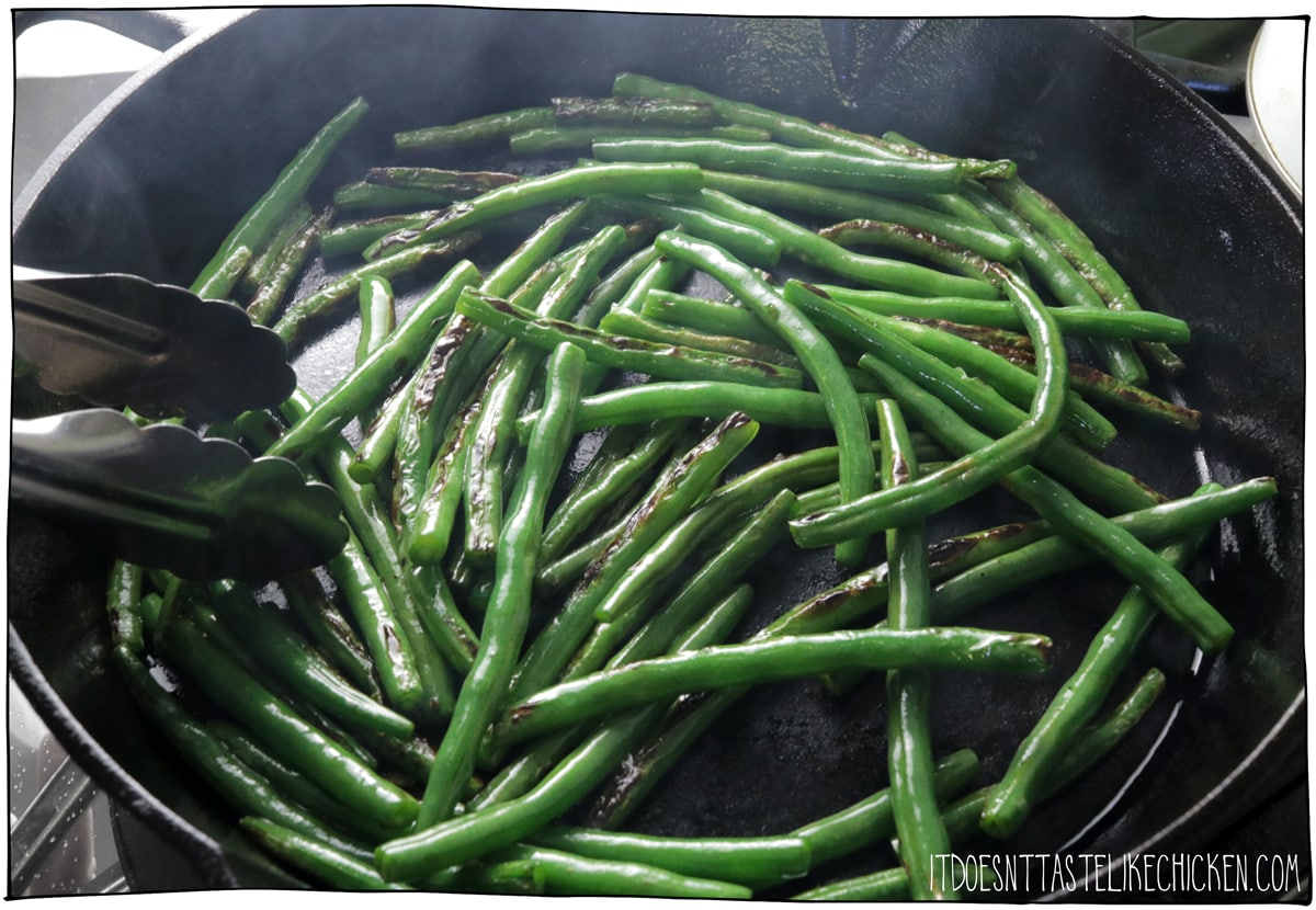 Sautee the green beans in oil until they begin to char.