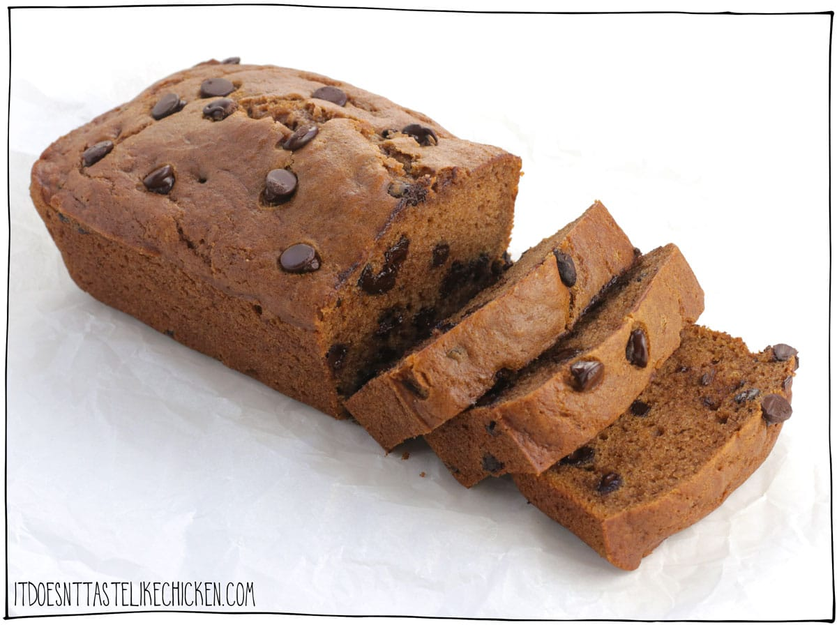 This Vegan Chocolate Chip Pumpkin Bread is so tender, it's deliciously moist, chocolatey, pumpkin infused, and surprisingly easy to make too! Just whip up the simple batter, pour in a pan, and bake. That's it. And if you don't like chocolate (weirdo), you can either omit the chocolate chips, or replace them with crunchy walnuts, pecans, or pepitas. #itdoesnttastelikechicken #veganbaking #pumpkin