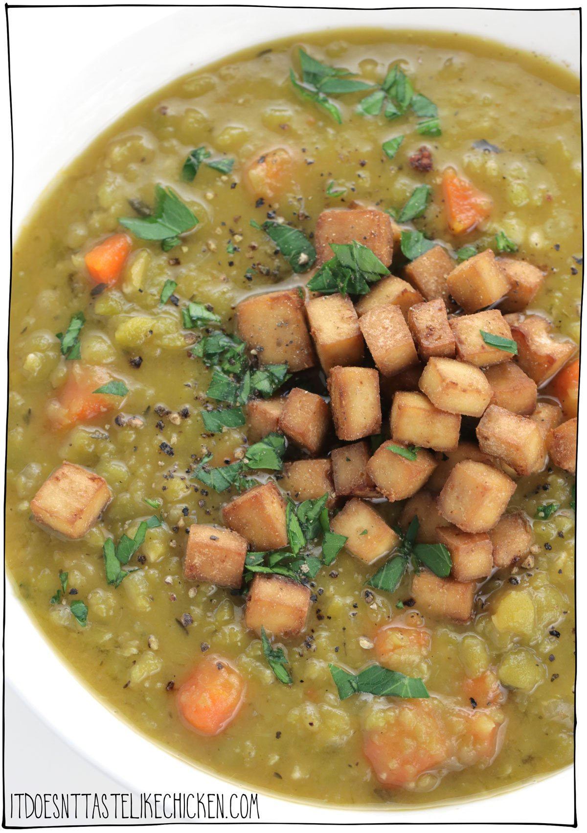 Easy Vegan Split Pea Soup with Smoky Tofu Ham! Hearty, flavor-packed, warming, and lick the bowl scrumptious! There is a reason this classic soup recipe is a staple for many: it's easy to make, it uses inexpensive ingredients, and oh my is it ever delicious. The perfect make-ahead meal. #itdoesnttastelikechicken #veganrecipes #soup