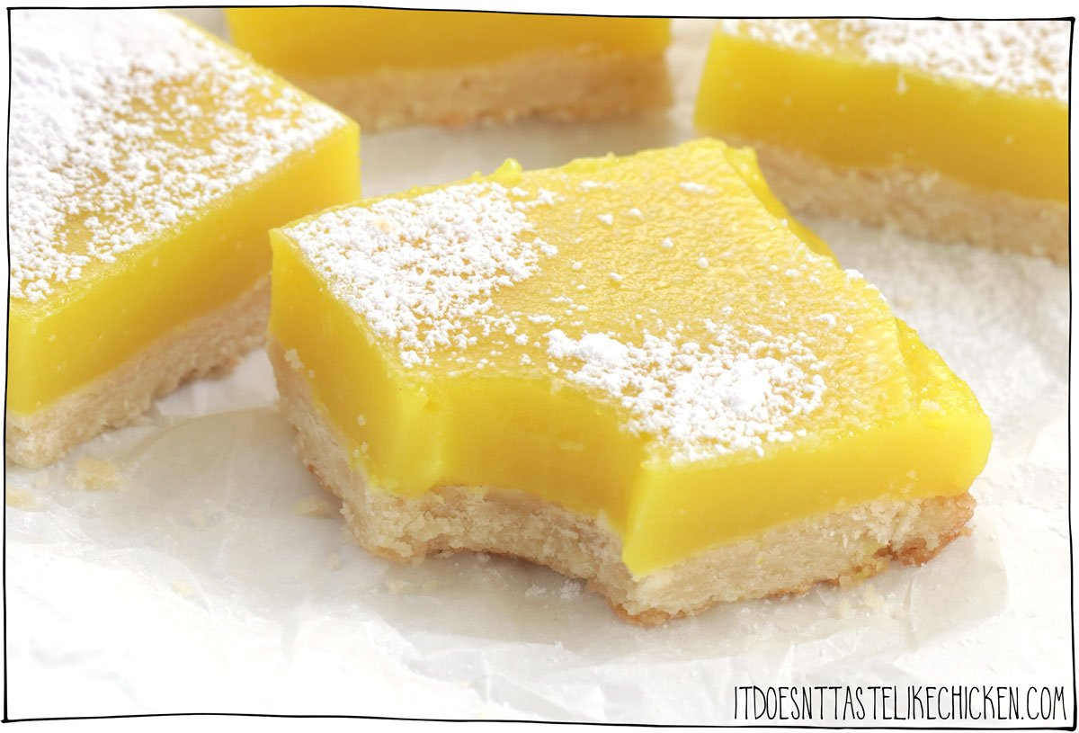 Easy Vegan Lemon Squares! These lemon bars are so easy to make and are a perfect combination of fresh, tart lemon curd and a crumbly, buttery shortbread crust. Sweet and buttery and perfect for an Easter treat or a spring dessert. #itdoesnttastelikechicken #veganrecipes #vegandesserts
