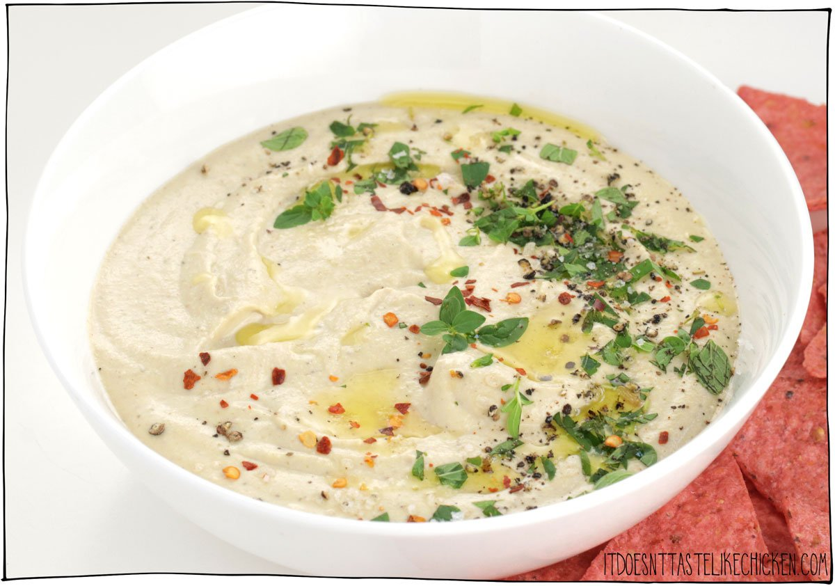 Just 7 ingredients and 20 minutes or less to make this easy vegan whipped feta dip! The perfect vegan appetizer for parties or a snack for yourself. Creamy, fluffy, cheesy, and tangy! #itdoesnttastelikechicken #veganappetizer
