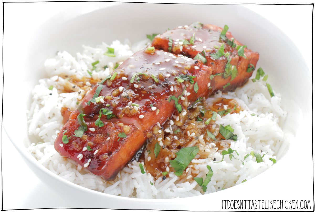 This is vegan seafood at its finest! This tofish (tofu fish) looks like and tastes like salmon. How cool is that!? Sticky garlic vegan salmon is perfect served over a bed of rice or on rice noodles. This looks fancy but this recipe is fairly easy to make as well using ingredients you can find at your local grocery store. #itdoesnttastelikechicken #veganrecipe #veganseafood