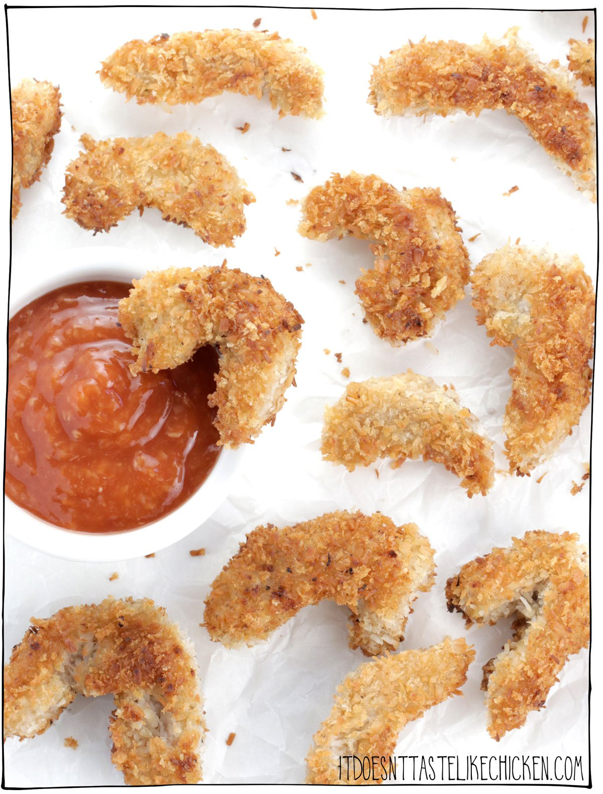 Coconut Crusted Vegan Shrimp! Golden, crispy, coconut coated on the outside, lightly chewy, juicy, with a slight taste of the sea on the inside. Serve these with homemade cocktail sauce for a real crowd-pleaser. The secret ingredient to make these shrimp: soy curls! Oil-free and air fryer versions are included in the recipe notes! #itdoesnttastelikechicken #veganshrimp #veganseafood